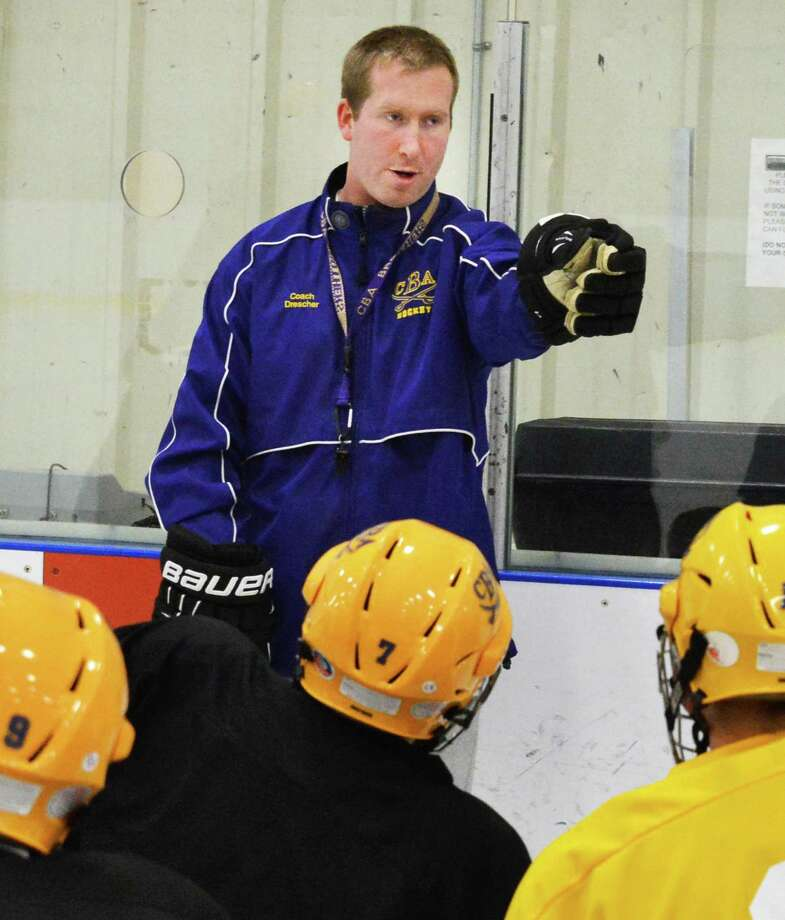 CBA hockey coach Blaine Drescher with players during practice at the Albany County Ice Rink in Colonie Thursday Dec. 20, 2012.  (John Carl D'Annibale / Times Union) Photo: John Carl D'Annibale / 00020542A