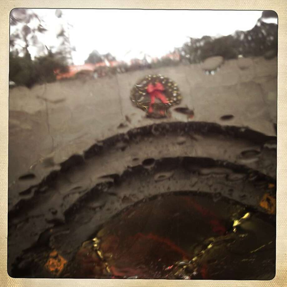 Rain saturates a holiday wreath on the tunnel at Yerba Buena Island on Friday Dec. 21, 2012 in San Francisco, Calif. Photo: Mike Kepka, The Chronicle