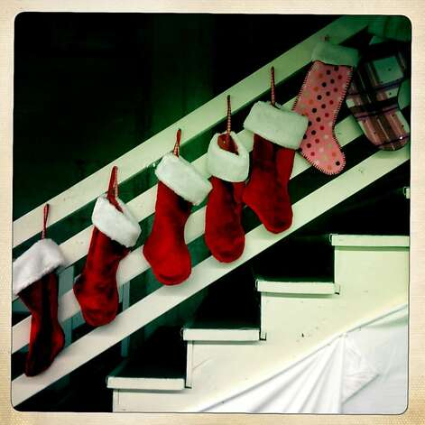 Christmas stockings line a staircase at a Salvation Army holiday toy giveaway in San Francisco, Calif. on Thursday, Dec. 20, 2012. Photo: Paul Chinn, The Chronicle