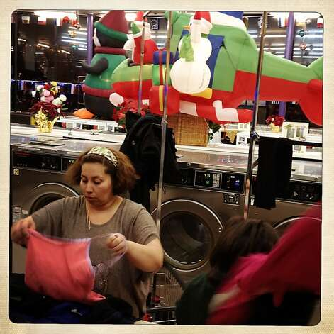 Nancy Kaufman folding wash with her 2 year old Francesca Kaufman (right) at a Clean Wash Center & Dry Cleaners laundromat on Mission at Persia streets in San Francisco, California, on Thursday,  December 20, 2012. Photo: Liz Hafalia, The Chronicle