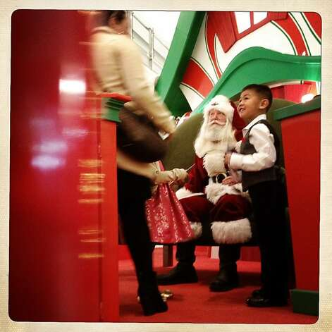 Noah Ramilo, 6 years old, from South San Francisco visiting Santa at the Tanforan Mall for a picture in San Bruno, California, on Thursday,  December 20, 2012. Photo: Liz Hafalia, The Chronicle