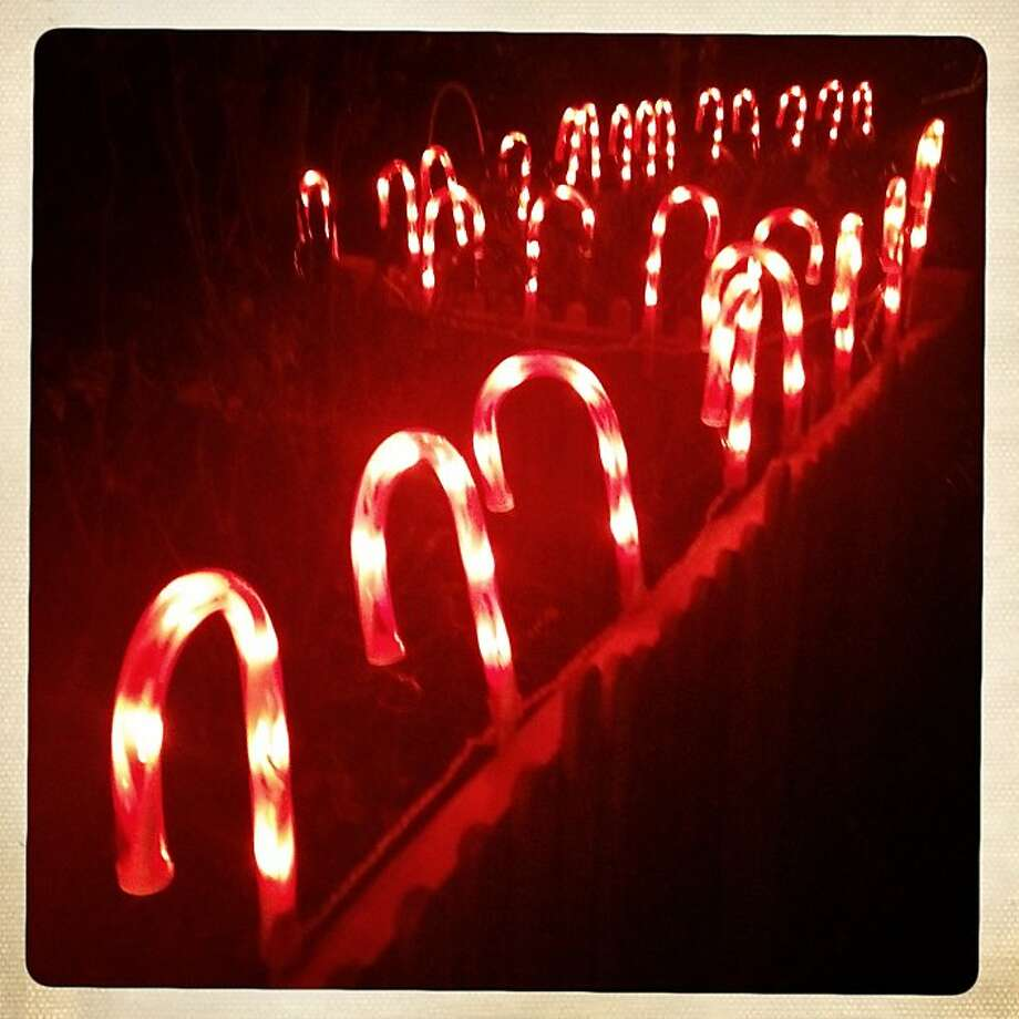 Candy Canes light the path to a home on Thursday Dec. 20, 2012 in Oakland, Calif. Photo: Mike Kepka, The Chronicle