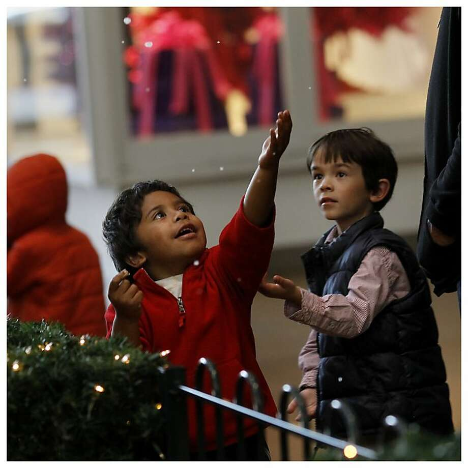 Young members of the Tabuya (left) and Chowanec (right) families checked out the fake snow at the Northgate Mall. The holidays are celebrated in many ways in the Bay Area.  In San Rafael, Calif. a visit to the Mission San Rafael Archangel, the 20th of the California missions established in 1817, is a historical and spiritual experience. And just north in the Northgate mall, the modern world has created artificial snow to the delight of young shoppers. Photo: Brant Ward, The Chronicle