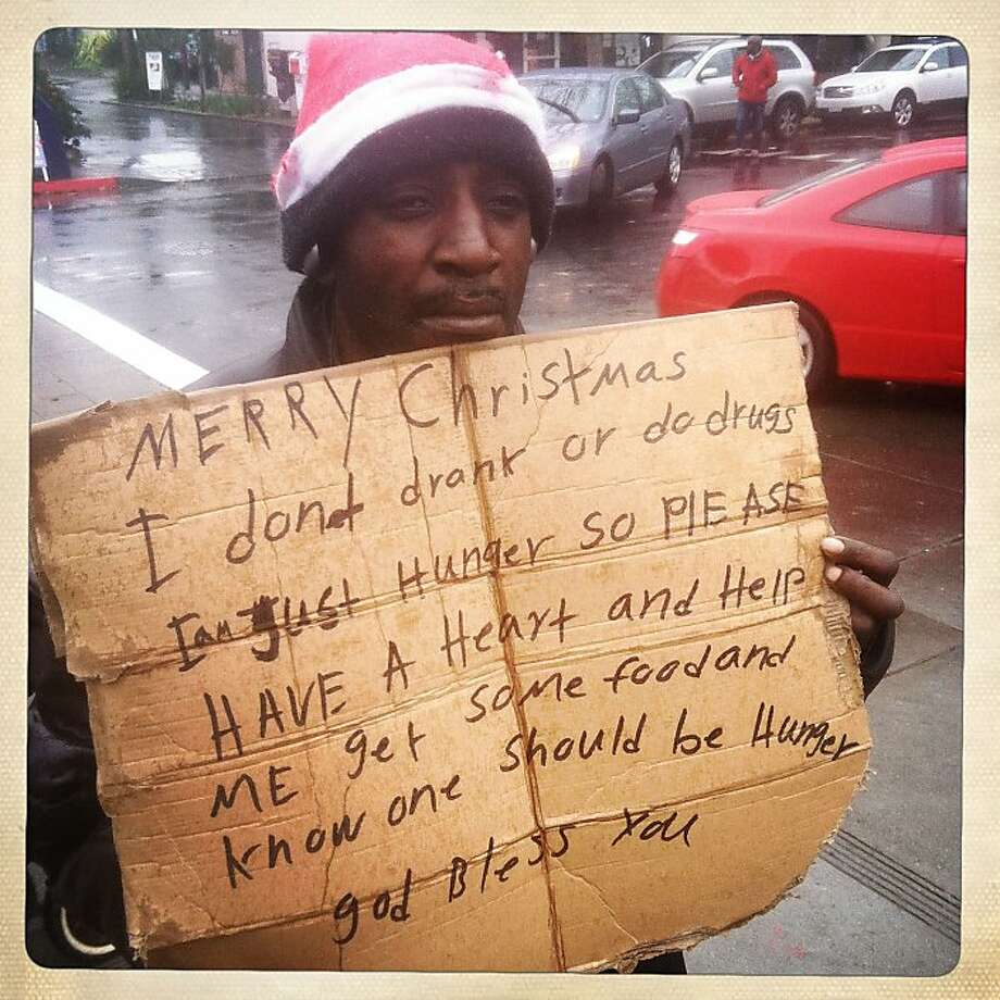 "Jerry Banks asks for donations on 4th St. on December 21, 2012 in Berkeley, Calif. ""Every little bit helps,"" said Banks. Photo: Sean Havey, The Chronicle"