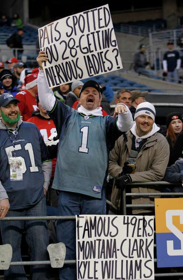 A Seattle Seahawks fan taunts San Francisco 49ers players with signs during pre-game warm-ups before an NFL football game, Sunday, Dec. 23, 2012, in Seattle. Photo: AP