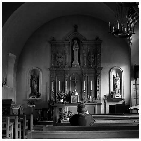 A young boy sat in the pews of the Mission late in the afternoon. The holidays are celebrated in many ways in the Bay Area.  In San Rafael, Calif. a visit to the Mission San Rafael Archangel, the 20th of the California missions established in 1817, is a historical and spiritual experience. And just north in the Northgate mall, the modern world has created artificial snow to the delight of young shoppers. Photo: Brant Ward, The Chronicle