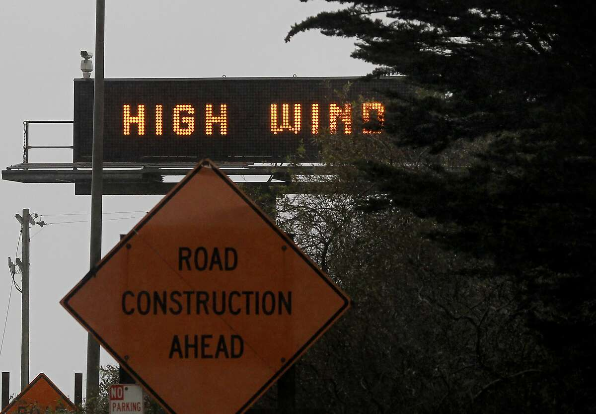 A sign warned motorists on the Golden Gate Bridge of strong winds. Later trucks were banned on the Richmond San Rafael bridge. A strong winter storm brought high winds to the Bay Area Sunday December 23, 2012 on one of the last shopping days before Christmas.
