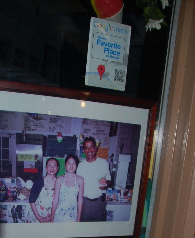 For local businesses, such as this shave ice store in the Koko Marina shopping center, a visit from the president is a source of pride. (Jeanne Cooper / SFGate)