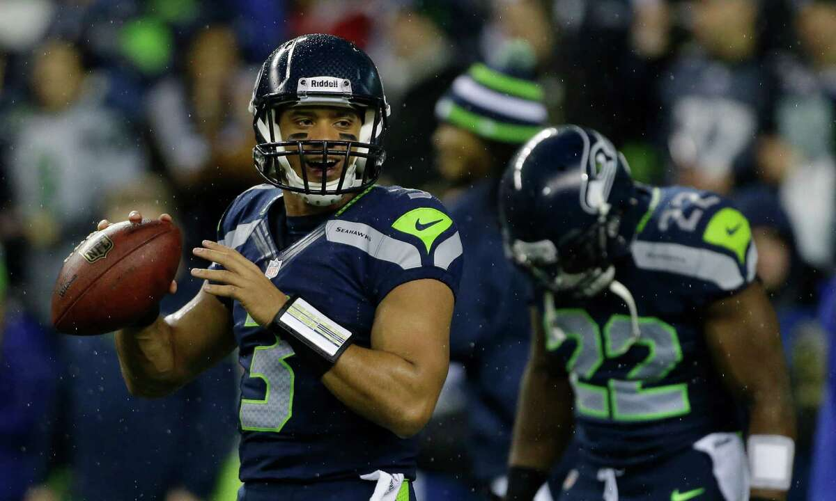 Seattle Seahawks quarterback Russell Wilson warms up prior to the start of an NFL football game against the San Francisco 49ers, Sunday, Dec. 23, 2012, in Seattle.