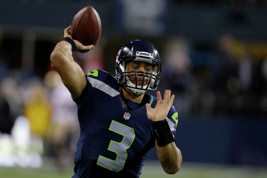 Seattle Seahawks quarterback Russell Wilson warms up prior to the start of an NFL football game against the San Francisco 49ers, Sunday, Dec. 23, 2012, in Seattle. Photo: AP