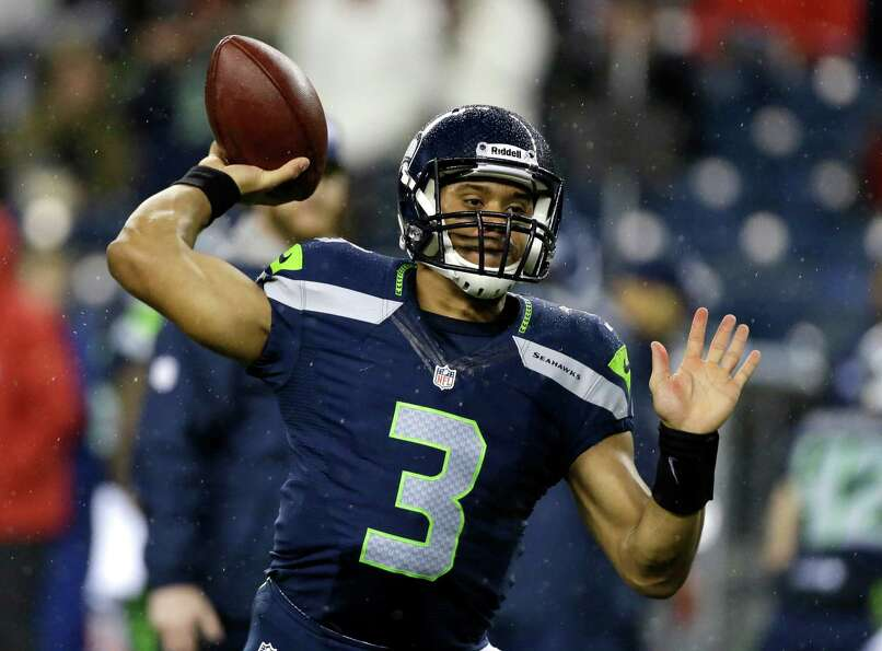 Seattle Seahawks quarterback Russell Wilson warms up prior to the start of an NFL football game agai