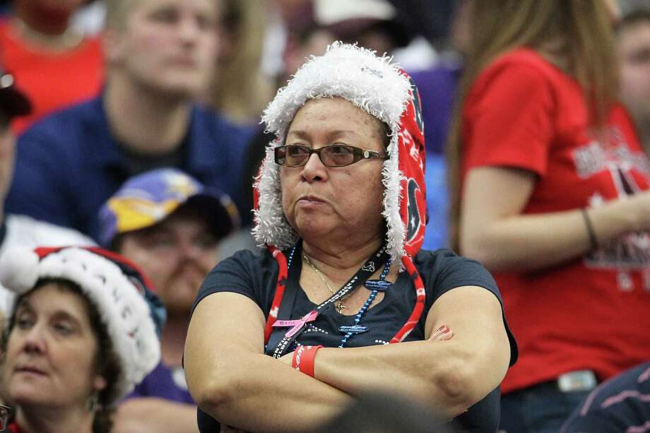A Texans fan reacts during the fourth quarter of the loss to the Vikings. Photo: Karen Warren, Houston Chronicle / © 2012 Houston Chronicle