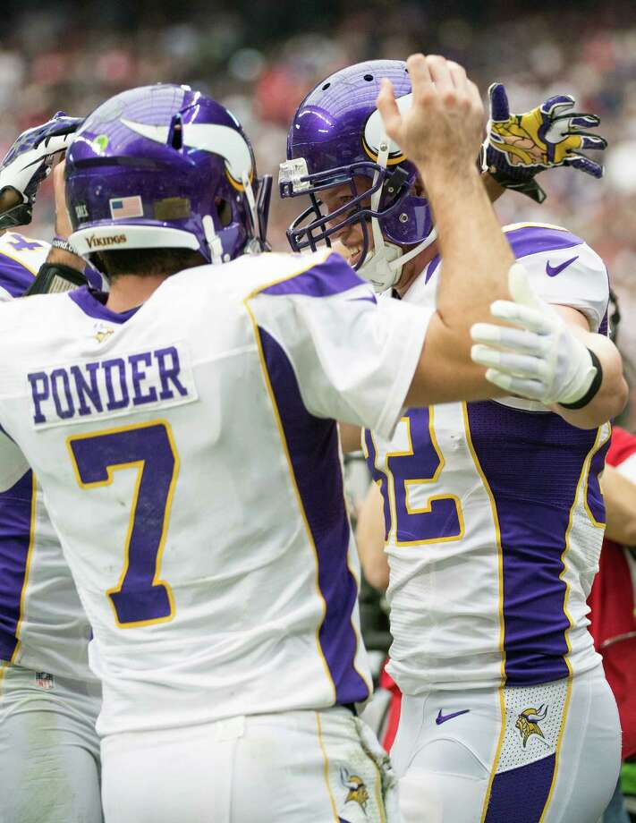 Vikings tight end Kyle Rudolph (82) celebrates with quarterback Christian Ponder (7) after scoring on a 3-yard touchdown pass during the first quarter. Photo: Smiley N. Pool, Houston Chronicle / © 2012  Houston Chronicle