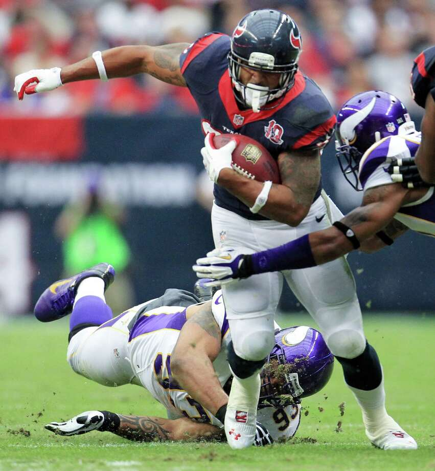 Texans running back Arian Foster (23) gets past Vikings defensive tackle Kevin Williams (93) during the first quarter. Photo: Karen Warren, Houston Chronicle / © 2012 Houston Chronicle