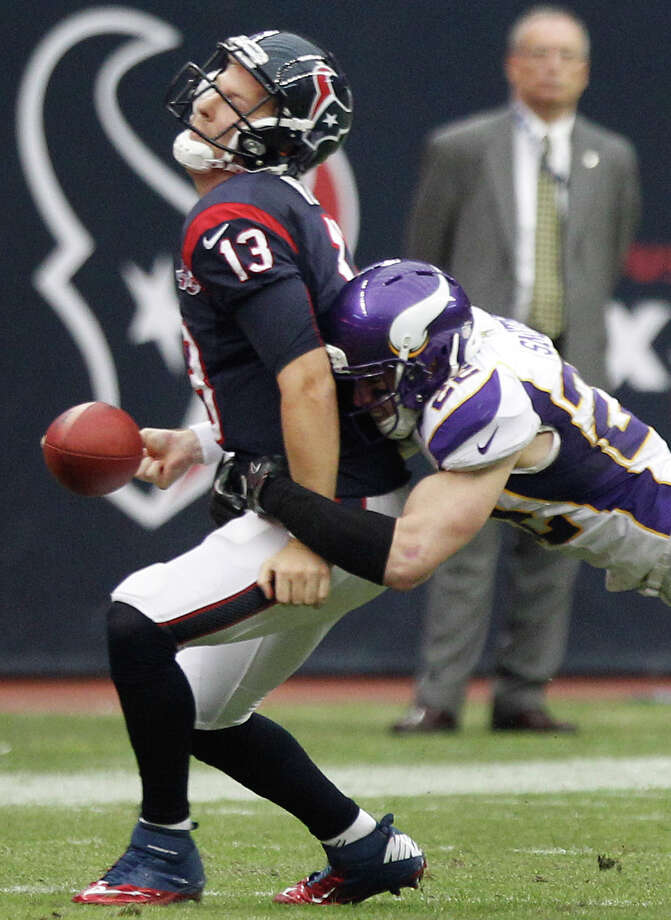 Texans quarterback T.J. Yates (13) fumbles as he is hit by Vikings free safety Harrison Smith (22) during the fourth quarter. Photo: Brett Coomer, Houston Chronicle / © 2012  Houston Chronicle