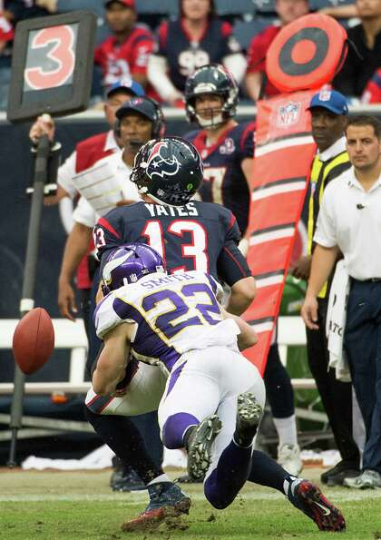 Texans quarterback T.J. Yates (13) fumbles as he is hit by Vikings free safety Harrison Smith (22) d