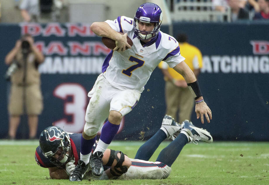 Vikings quarterback Christian Ponder (7) gets past Texans defensive end J.J. Watt (99) on a 29-yard scramble during the fourth quarter. Photo: Smiley N. Pool, Houston Chronicle / © 2012  Houston Chronicle