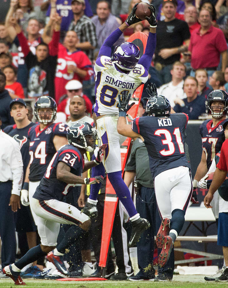 Vikings wide receiver Jerome Simpson (81) catches a 17-yard pass on a 3rd-and-13 play as Texans defensive backs Johnathan Joseph (24) and Shiloh Keo (31) defend during the fourth quarter. Photo: Smiley N. Pool, Houston Chronicle / © 2012  Houston Chronicle