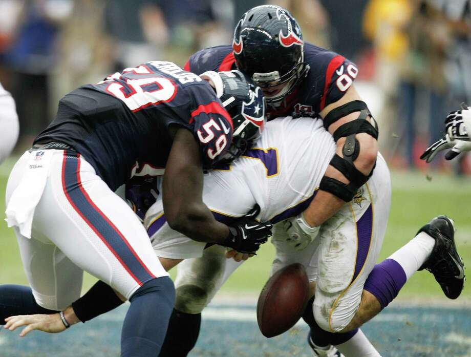Texans linebacker Whitney Mercilus (59) and defensive end J.J. Watt (99) force a fumble as they sack Vikings quarterback Christian Ponder (7) during the third quarter. Photo: Brett Coomer, Houston Chronicle / © 2012  Houston Chronicle