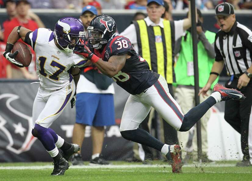 Texans free safety Danieal Manning (38) commits a face mask penalty as he brings down Vikings wide r
