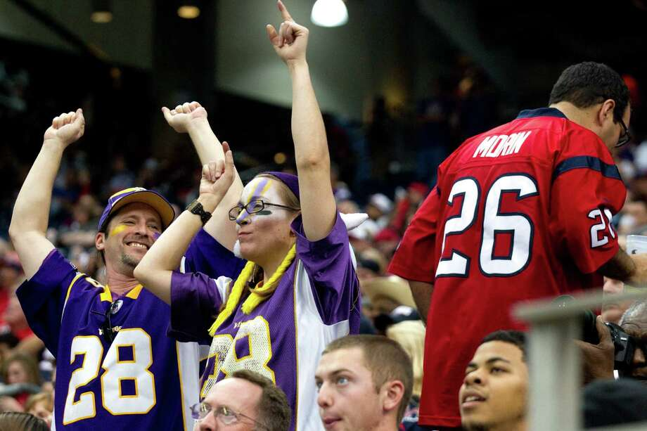 A pair of Vikings fans celebrate the Vikings win over the Texans during the fourth quarter. Photo: Brett Coomer, Houston Chronicle / © 2012  Houston Chronicle