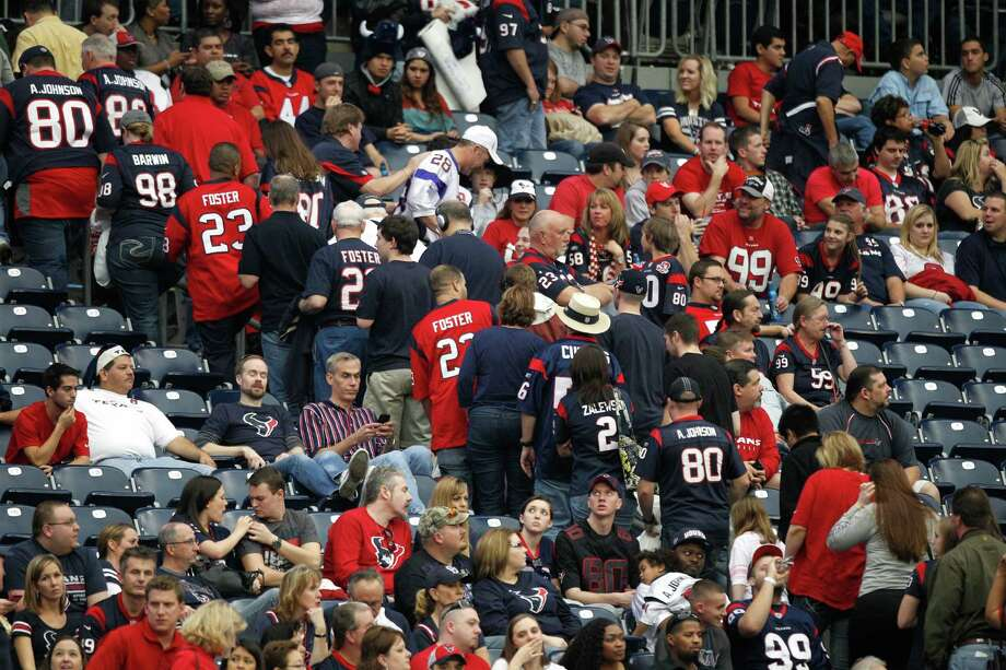Texans fans leave the stadium during the fourth quarter against the Minnesota Vikings. Photo: Brett Coomer, Houston Chronicle / © 2012  Houston Chronicle