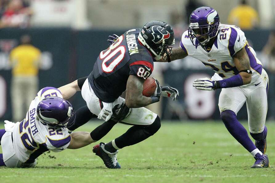 Texans wide receiver Andre Johnson (80) is brought down by Vikings free safety Harrison Smith (22) a