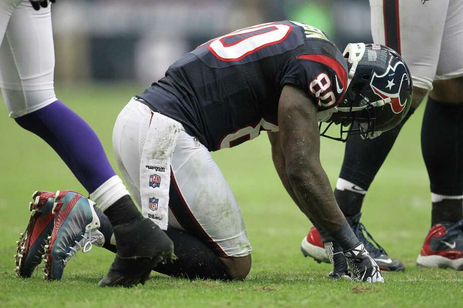 Texans wide receiver Andre Johnson gets up slowly after a play during the third quarter. Photo: Karen Warren, Houston Chronicle / © 2012 Houston Chronicle