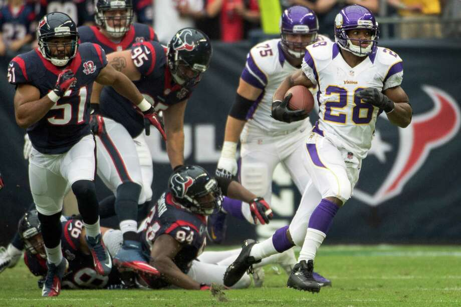 Vikings running back Adrian Peterson (28) gets past Texans linebacker Connor Barwin (98), defensive end Antonio Smith (94), nose tackle Shaun Cody (95) and linebacker Darryl Sharpton (51) on a 20-yard gain during the first quarter. Photo: Smiley N. Pool, Houston Chronicle / © 2012  Houston Chronicle