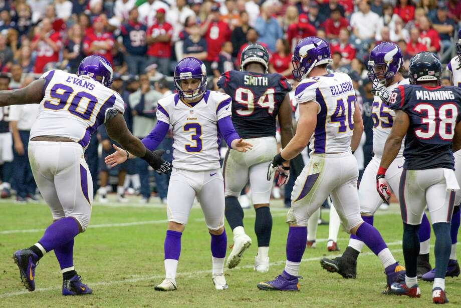 Vikings kicker Blair Walsh (3) celebrates with Fred Evans (90) after kicking a field goal during the second quarter. Photo: Brett Coomer, Houston Chronicle / © 2012  Houston Chronicle