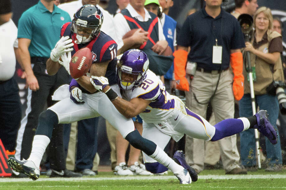 Vikings cornerback Chris Cook (20) breaks up a pass intended for Texans wide receiver DeVier Posey (11) during the first quarter. Photo: Smiley N. Pool, Houston Chronicle / © 2012  Houston Chronicle
