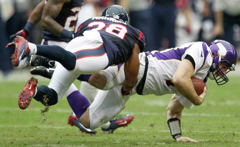 Vikings quarterback Christian Ponder (7) is brought down by Texans free safety Danieal Manning (38) during the second quarter. Photo: Brett Coomer, Houston Chronicle / © 2012  Houston Chronicle