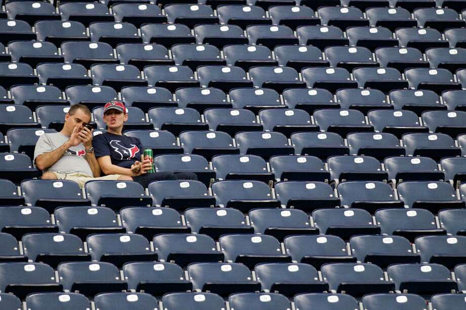 Texans sit in mostly-vacated seats during the fourth quarter. Photo: Brett Coomer, Houston Chronicle / © 2012  Houston Chronicle