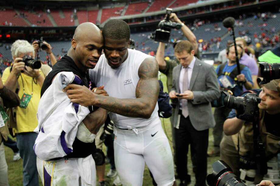 Vikings running back Adrian Peterson, left, and Texans wide receiver Andre Johnson embrace after the Vikings win. Photo: Brett Coomer, Houston Chronicle / © 2012  Houston Chronicle