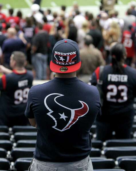 Texans fans watch pre-game warmups before the game.