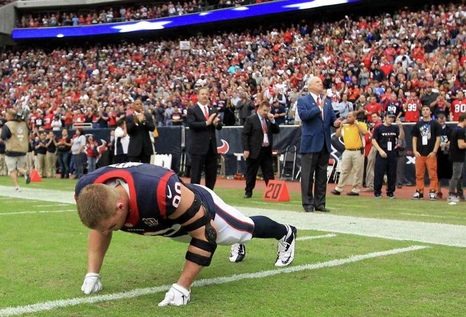 Texans defensive end J.J. Watt does pushups on the field before the game. Photo: Karen Warren, Houston Chronicle / © 2012 Houston Chronicle