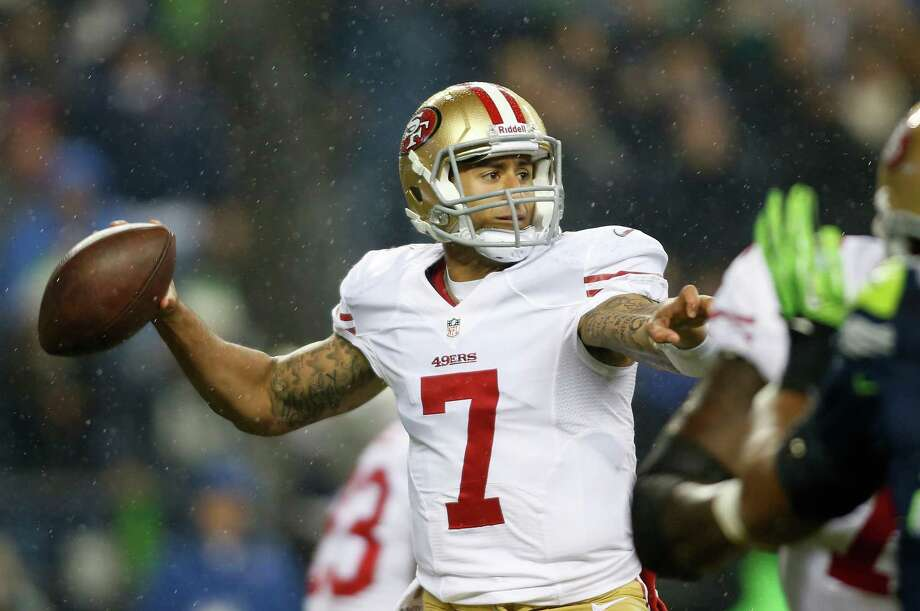 San Francisco 49ers quarterback Colin Kaepernick looks to pass in the first half of an NFL football game against the Seattle Seahawks on Sunday in Seattle. Photo: AP