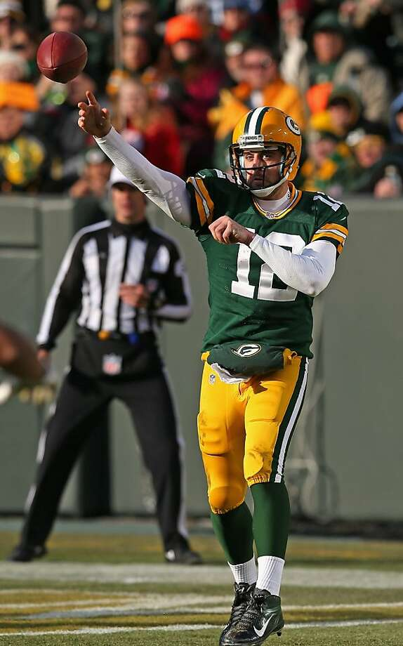 Aaron Rodgers passed for three touchdowns and 342 yards, tying his season high, though he rested much of the fourth quarter. He ran for one touchdown. Photo: Jonathan Daniel, Getty Images