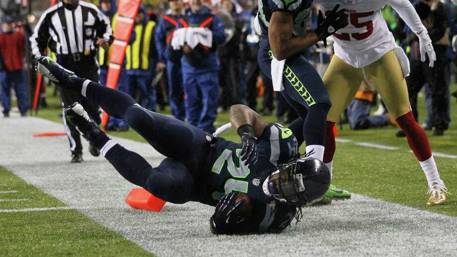 Seattle Seahawks' Marshawn Lynch scores a touchdown against the San Francisco 49ers in the first half of an NFL football game on Sunday in Seattle. Photo: AP