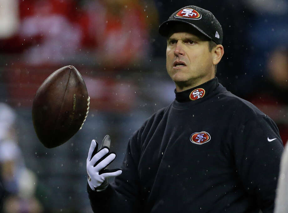San Francisco 49ers head coach Jim Harbaugh tosses the football prior to the start of an NFL football game against the Seattle Seahawks, Sunday, Dec. 23, 2012, in Seattle. Photo: AP