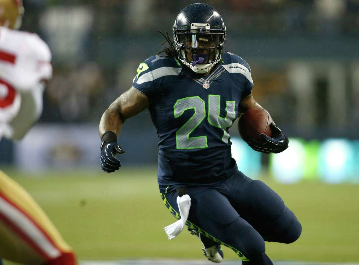 Seattle Seahawks' Marshawn Lynch (24) runs for a touchdown against the San Francisco 49ers in the first half of an NFL football game on Sunday in Seattle.
