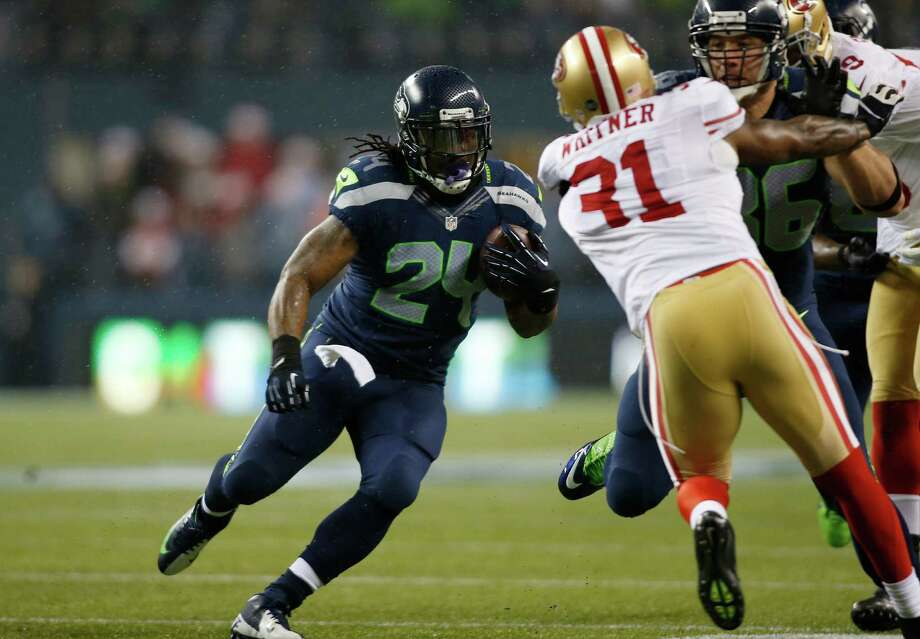 Seattle Seahawks' Marshawn Lynch (24) runs for a touchdown against the San Francisco 49ers in the first half of an NFL football game on Sunday in Seattle. Photo: AP