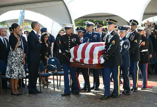 U.S. President Barack Obama and First Lady Michelle Obama stand as the casket passes during the funeral services for the late Senator Daniel Inouye at the National Memorial Cemetery of the Pacific December 23, 2012 in Honolulu, Hawaii. Senator Inouye was a Medal of Honor recipient and a United States Senator since 1963.  (Photo Cory Lum-Pool/Getty Images) Photo: Pool, Getty Images