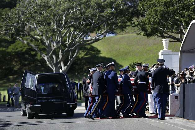 An honor guard carries the casket Sen. Daniel Inouye, D-Hawaii, at his memorial Service, at the Punchbowl National Memorial Cemetery of the Pacific in Honolulu, Sunday, Dec. 23, 2012. (AP Photo/Gerald Herbert) Photo: Gerald Herbert, Associated Press