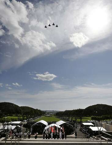 Military jets perform a flyover during the Memorial Service for Sen. Daniel Inouye, D-Hawaii, attended by President Barack Obama, at the Punchbowl National Memorial Cemetery of the Pacific in Honolulu, Sunday, Dec. 23, 2012. (AP Photo/Gerald Herbert) Photo: Gerald Herbert, Associated Press