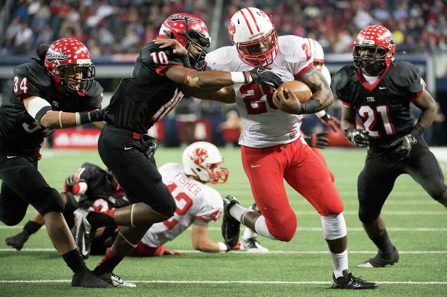 Katy running back Adam Taylor (28) pushes his way in for one of his five touchdowns on Saturday. Photo: Smiley N. Pool, Staff / © 2012  Houston Chronicle