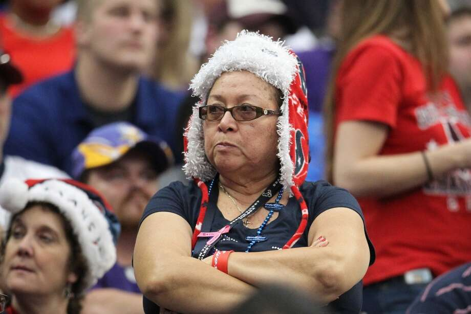 A Texans fan reacts during the fourth quarter of the loss to the Vikings. (Karen Warren / Houston Chronicle)