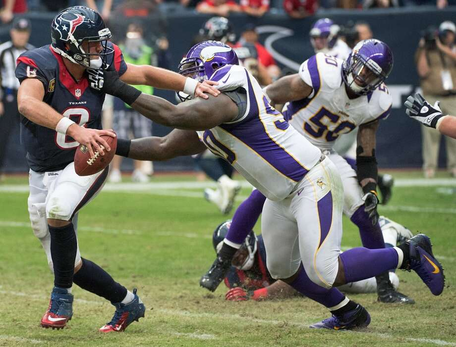 Minnesota defensive tackle Fred Evans (90) drops Texans quarterback Matt Schaub (8) for a 14-yard loss during the third quarter. The play came on a third-and-goal at the Vikings 1-yard line, forcing the Texans to settle for a field goal. (Smiley N. Pool / Houston Chronicle)