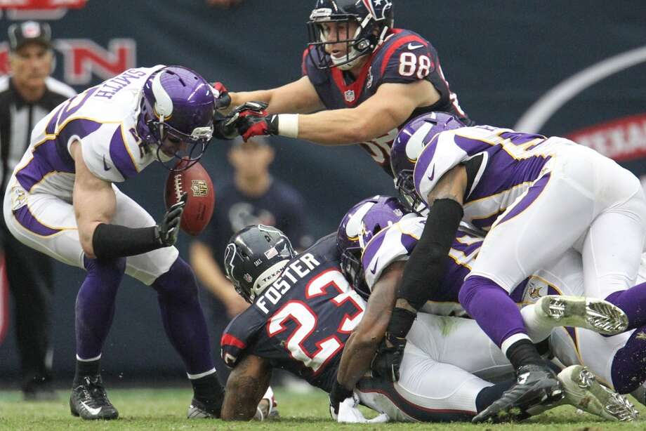 Vikings free safety Harrison Smith (22) recovers a fumble by Texans running back Arian Foster (23) during the second quarter. (Karen Warren / Houston Chronicle)
