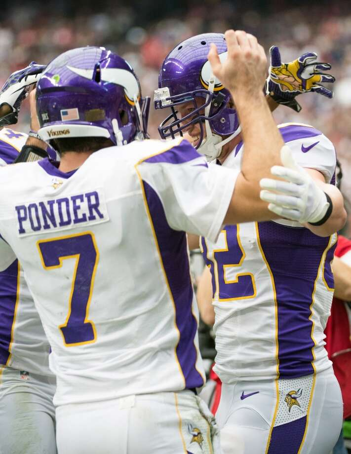 Vikings tight end Kyle Rudolph (82) celebrates with quarterback Christian Ponder (7) after scoring on a 3-yard touchdown pass during the first quarter. (Smiley N. Pool / Houston Chronicle)